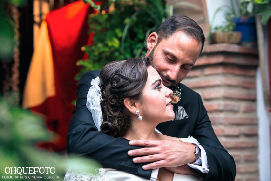 reportaje de boda en los patios de cordoba-ohquefoto-fotografos-de-boda-video-de-boda en la iglesia de san lorenzo-elenayjose-bodas en cordoba724